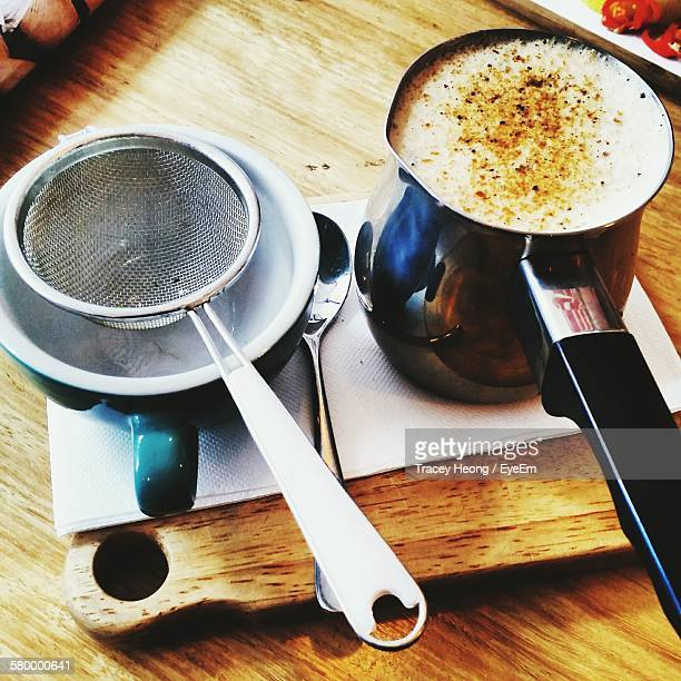 high angle view of chai latte in utensil - chai stock photos and pictures