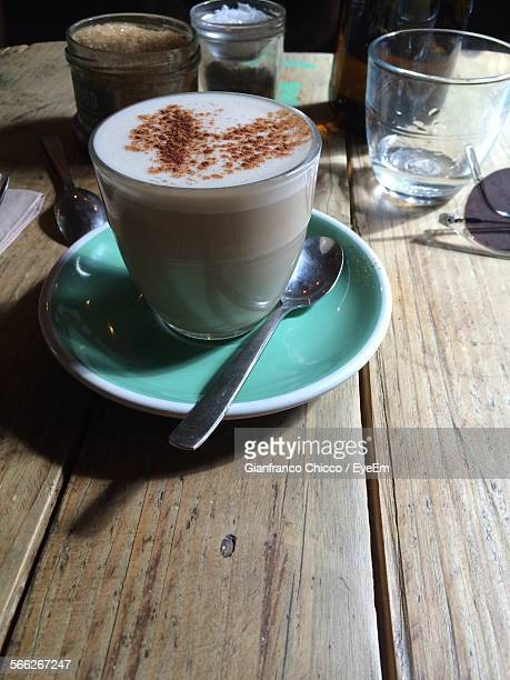 High Angle View Of Chai Latte On Wooden Table