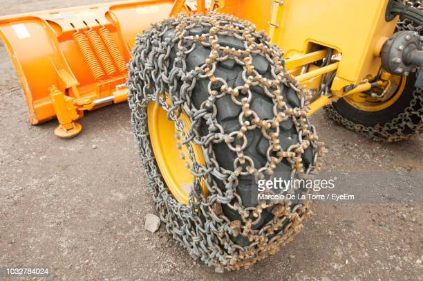 high angle view of chain on earthmover tire - durability stock photos and pictures