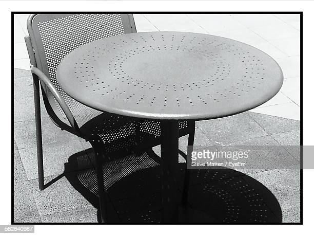 high angle view of chair and table outdoors - steve matten stock pictures, royalty-free photos & images