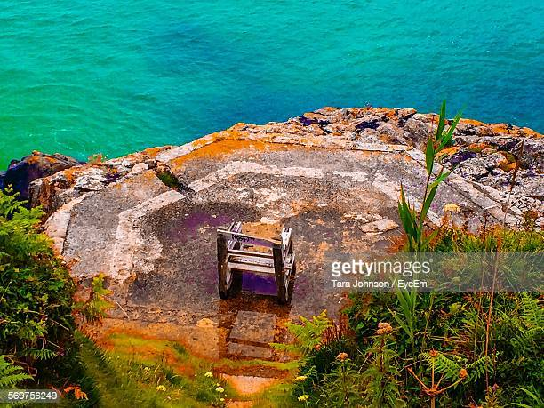 high angle view of chair at observation point against sea - st ives stock pictures, royalty-free photos & images