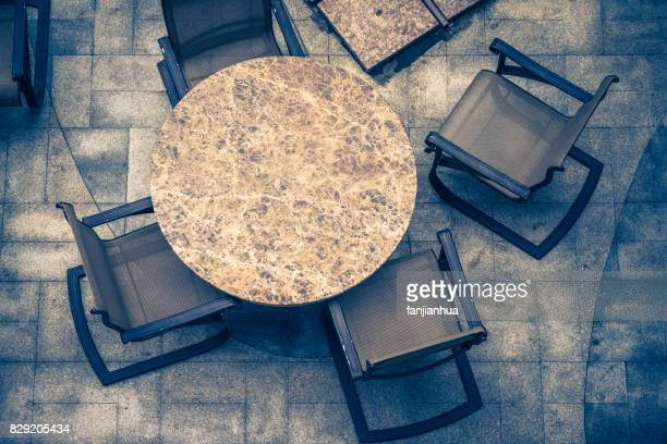 high angle view of chairs and tables at sidewalk cafe - terraced field stock pictures, royalty-free photos & images