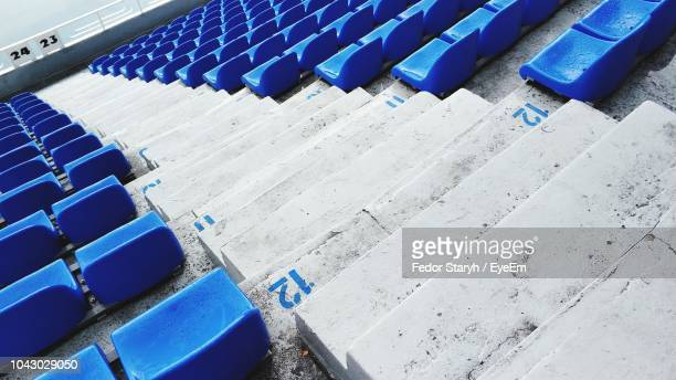 high angle view of chairs by steps in stadium - fedor stock pictures, royalty-free photos & images