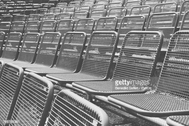 High Angle View Of Chairs In Row At Stadium