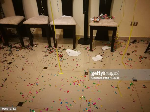 High Angle View Of Chairs On Tiled Floor With Confetti