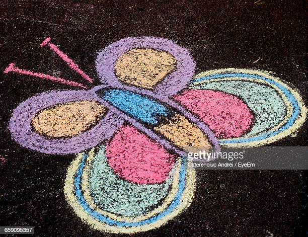 High Angle View Of Chalk Drawing On Road