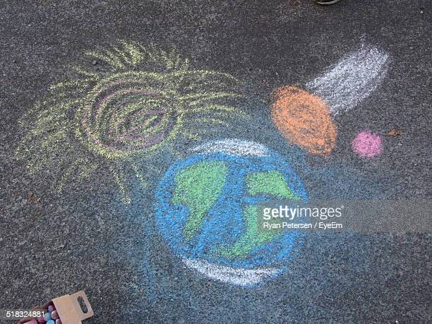 High Angle View Of Chalk Drawings On Street