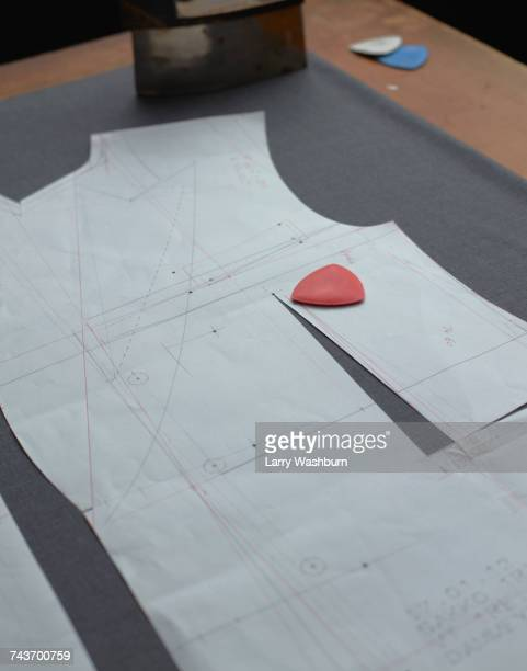 high angle view of chalk on paper with suit design at studio - jacket stock pictures, royalty-free photos & images