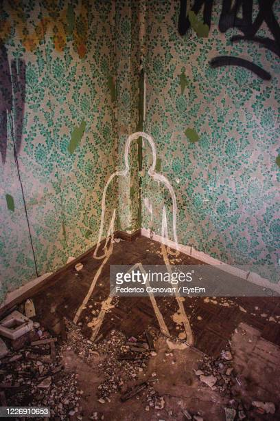 high angle view of chalk outline in abandoned room - dead body stock pictures, royalty-free photos & images