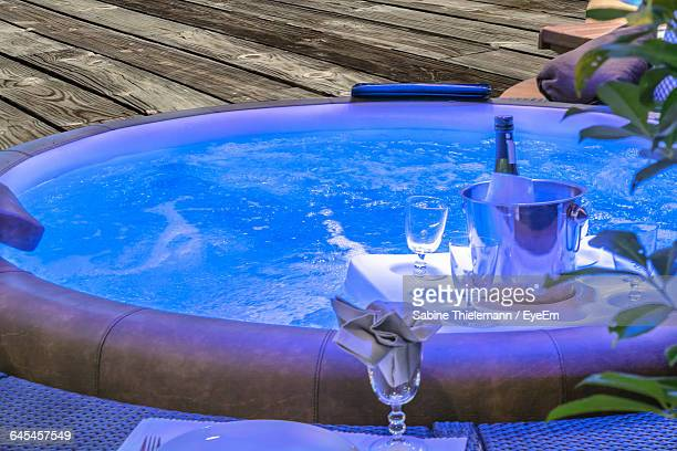 High Angle View Of Champagne In Bucket With Drinking Glass By Jacuzzi