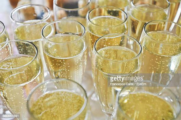 high angle view of champagnes served on table - champagne stock pictures, royalty-free photos & images