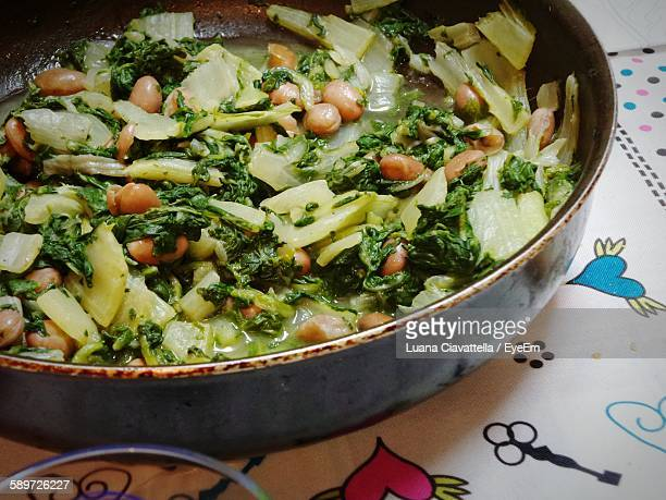 High Angle View Of Chard And Beans In Container On Table