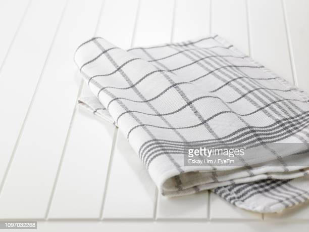 high angle view of checked pattern napkin on white table - テーブルナプキン ストックフォトと画像
