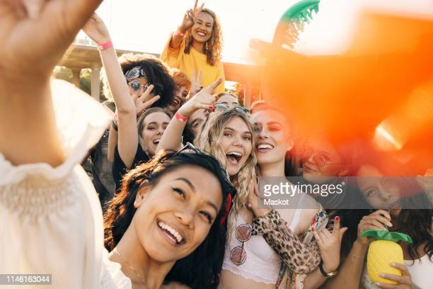 high angle view of cheerful friends enjoying in music event during summer - music festival crowd stock pictures, royalty-free photos & images