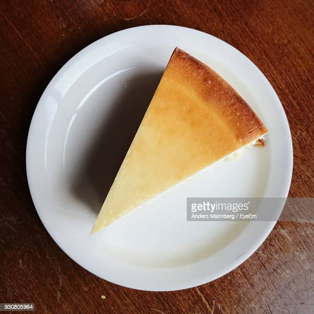 high angle view of cheesecake in plate on table - cheesecake stock pictures, royalty-free photos & images