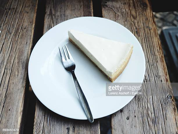 High Angle View Of Cheesecake On Table Served At Sidewalk Cafe