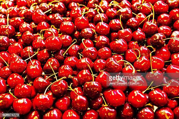high angle view of cherries for sale at market stall - jens siewert stock-fotos und bilder