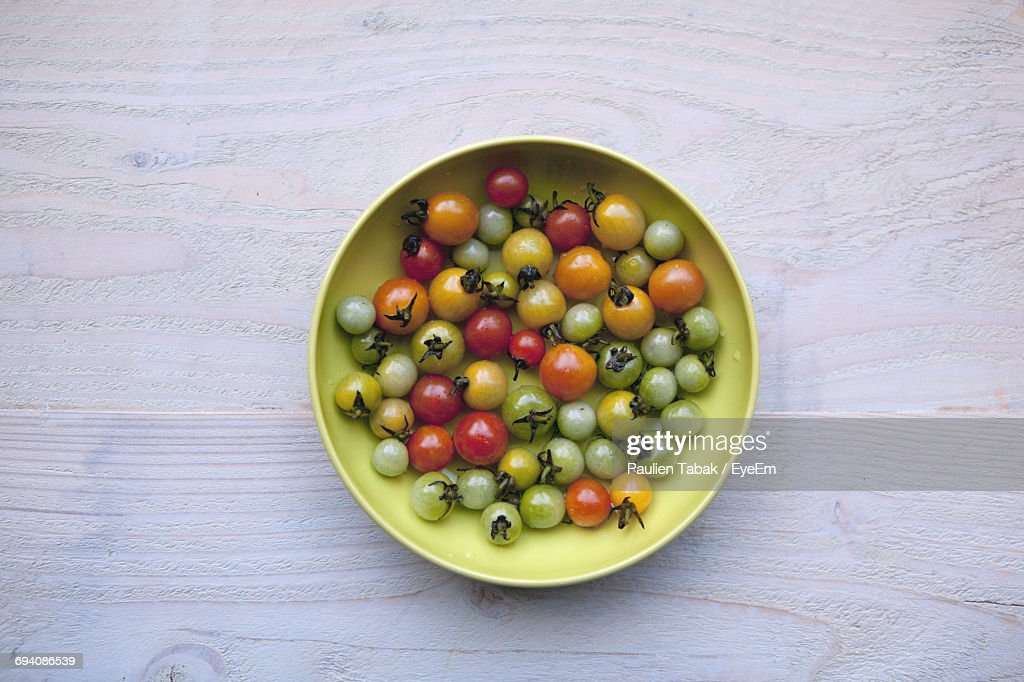 High Angle View Of Cherry Tomatoes In Plate : Stock Photo