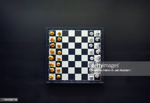 high angle view of chess board on black background - chess board stock pictures, royalty-free photos & images