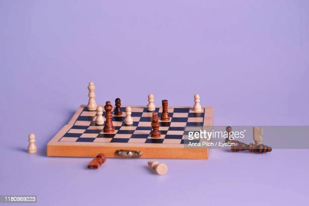 high angle view of chess board on purple background - chess board stock pictures, royalty-free photos & images