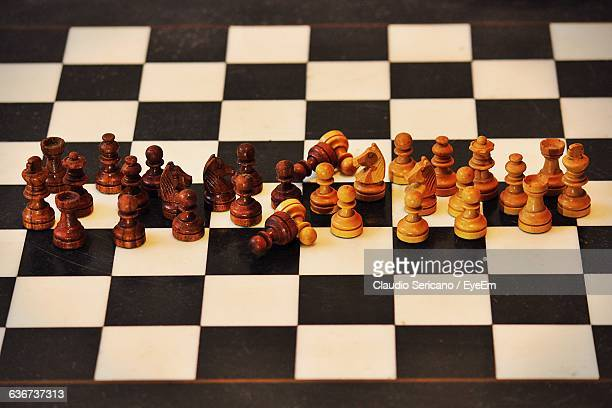 High Angle View Of Chess Pieces On Board