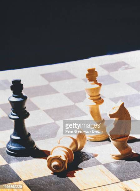 high angle view of chess pieces on table - bicester village stock pictures, royalty-free photos & images