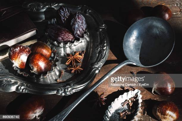 high angle view of chestnuts and spices on table - chestnut food stock pictures, royalty-free photos & images