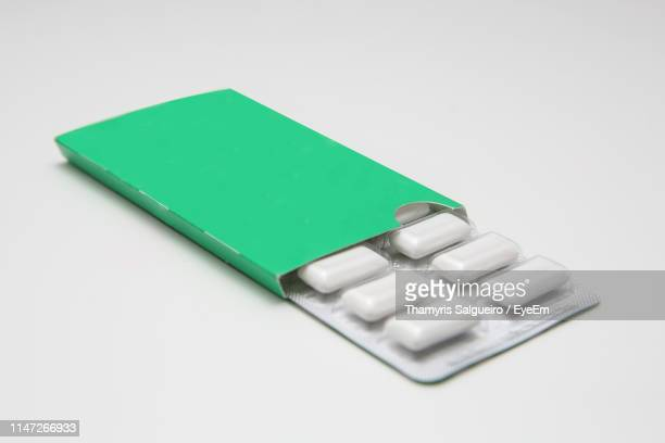 high angle view of chewing gum against white background - bubble gum stock pictures, royalty-free photos & images