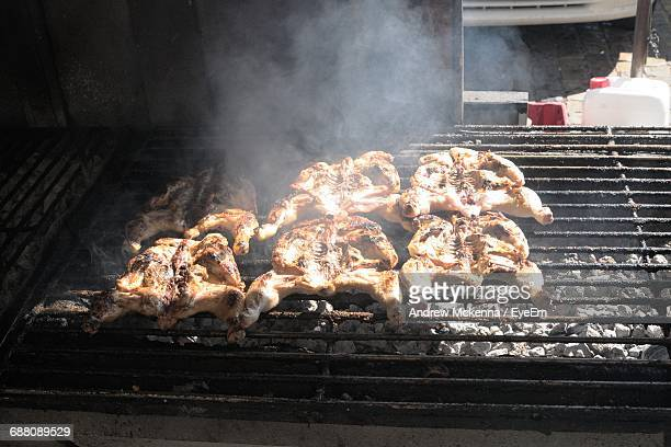 High Angle View Of Chicken Being Cooked On Barbecue Grill
