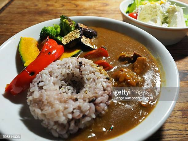High Angle View Of Chicken Curry With Rice In Bowl