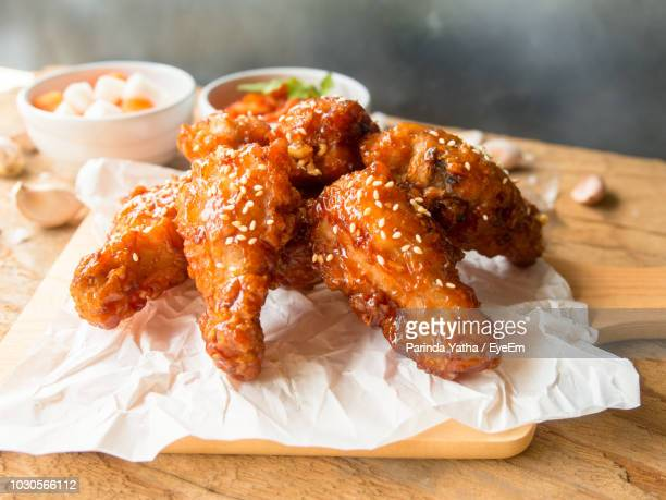high angle view of chicken meat served on wooden table - chicken wing stock pictures, royalty-free photos & images