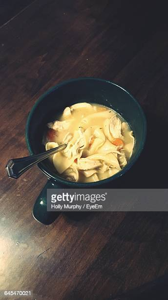 High Angle View Of Chicken Noodle Soup In Bowl On Table