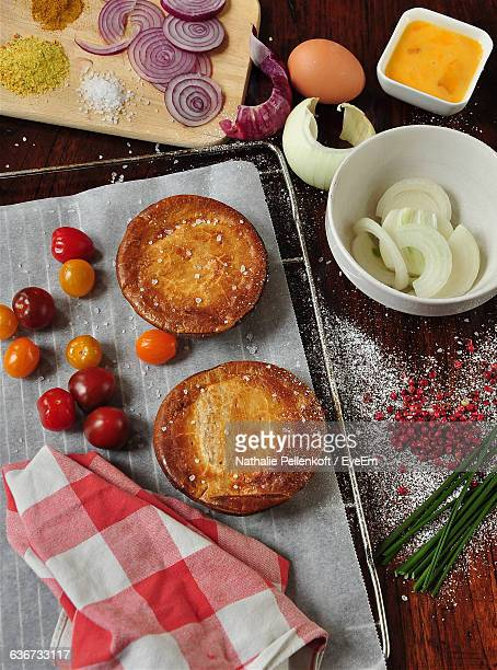 high angle view of chicken pot pie with ingredient on table - nathalie pellenkoft stock pictures, royalty-free photos & images