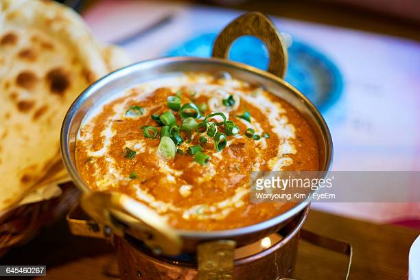 high angle view of chicken tikka in cooking pan - tikka masala stock pictures, royalty-free photos & images