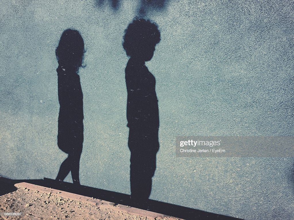 High Angle View Of Children Shadow On Street : Stock Photo
