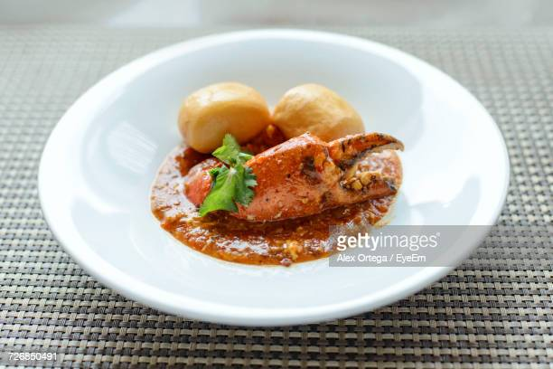 high angle view of chili crab and buns in plate - crab stock photos and pictures