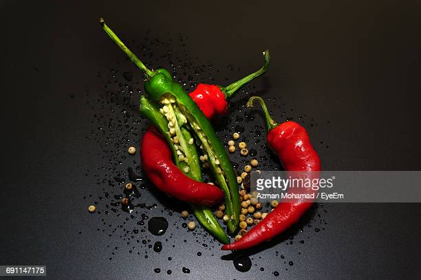 High Angle View Of Chili Peppers On Black Background