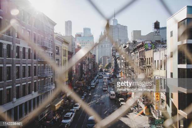 high angle view of chinatown from manhattan bridge - lower east side manhattan stock pictures, royalty-free photos & images