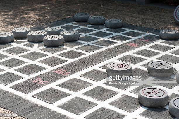 High Angle View Of Chinese Chess Board Game On Sunny Day