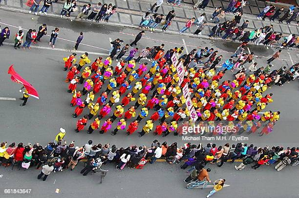 High Angle View Of Chinese New Year Parade On Street In City