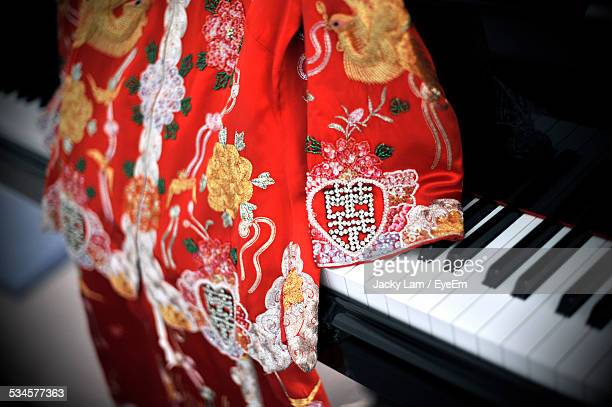 High Angle View Of Chinese Traditional Dress On Piano