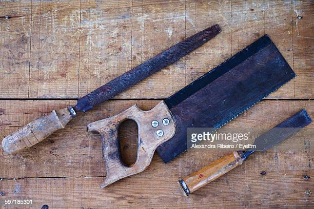 High Angle View Of Chisel With Hand Saw And Rasp On Wood