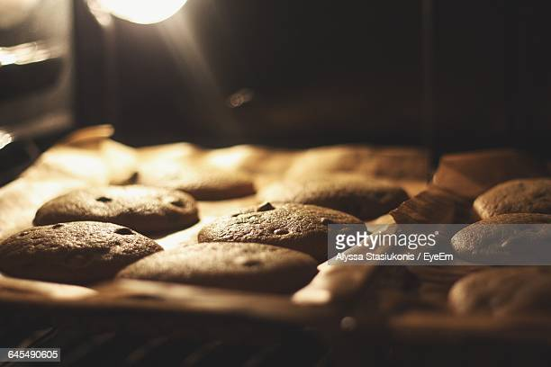 high angle view of chocolate chip cookies in oven - oven stock pictures, royalty-free photos & images