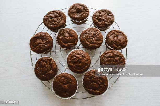 high angle view of chocolate muffins on table - チョコレートチップマフィン ストックフォトと画像