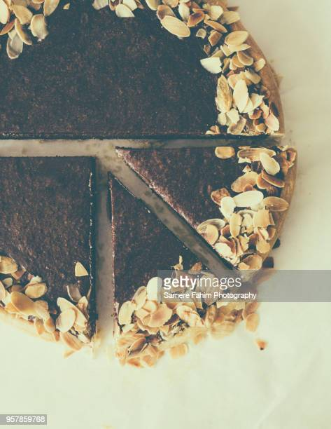 high angle view of chocolate pie with almonds - samere fahim stock photos and pictures