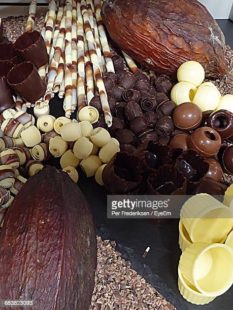 High Angle View Of Chocolates And Cocoa Beans On Table