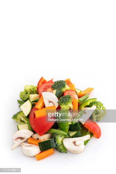 high angle view of chopped vegetables against white background - green bell pepper stock pictures, royalty-free photos & images