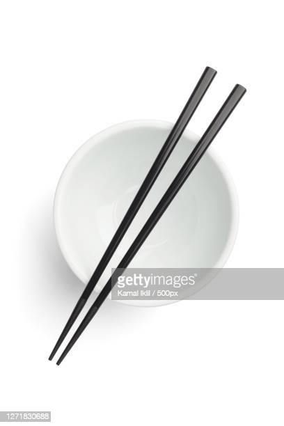 high angle view of chopsticks and chopsticks over white background, tokyo, japan - chopsticks stock pictures, royalty-free photos & images
