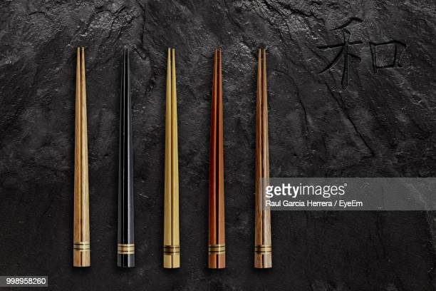 High Angle View Of Chopsticks On Slate