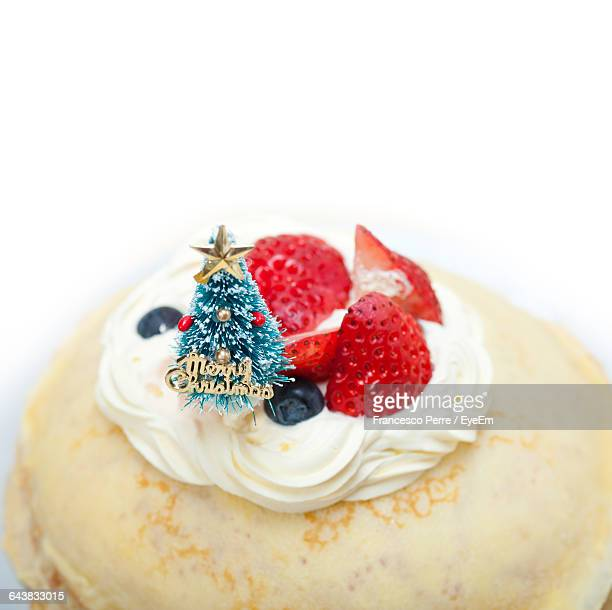 High Angle View Of Christmas Cake Over White Background